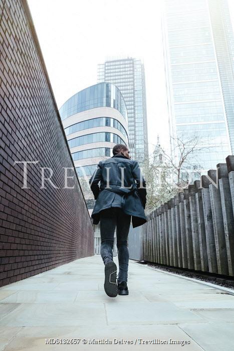 Matilda Delves MAN RUNNING IN MODERN CITY Men