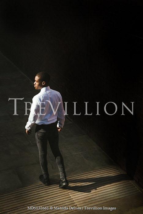 Matilda Delves MAN WALKING IN SHADOW IN CITY Men