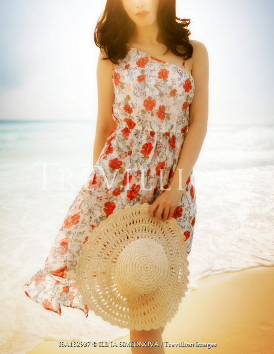 ILINA SIMEONOVA WOMAN IN FLORAL DRESS WITH HAT ON BEACH Women