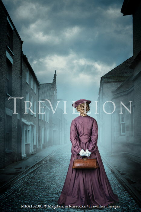 Magdalena Russocka historical woman holding medic bag standing on misty street
