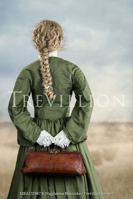 Magdalena Russocka historical woman holding medic bag standing in countryside