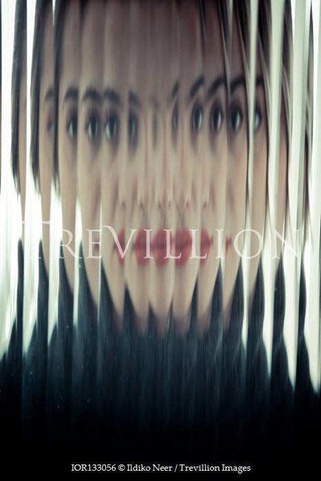 Ildiko Neer woman staring behind distorted glass
