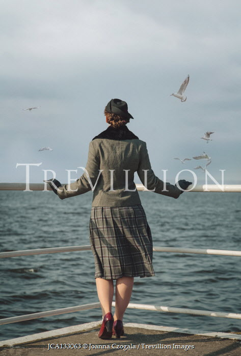 Joanna Czogala RETRO WOMAN BY RAILINGS WATCHING SEA Women