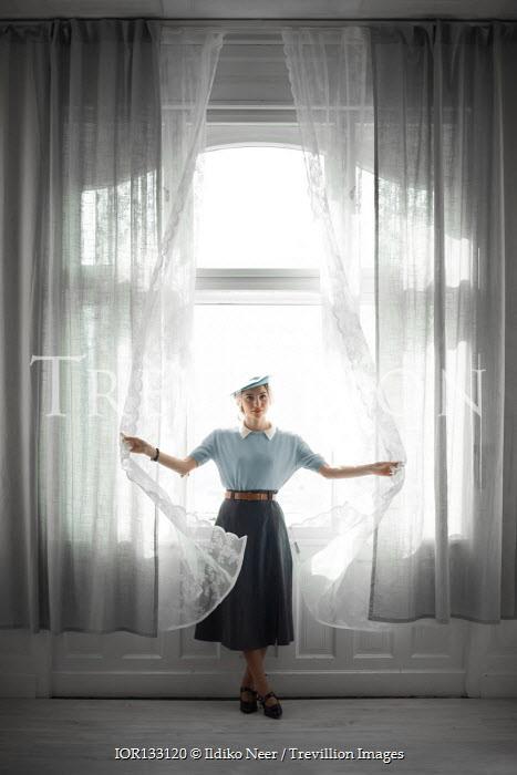 Ildiko Neer Retro woman opening curtains