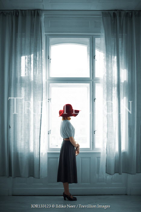 Ildiko Neer Retro woman standing at window