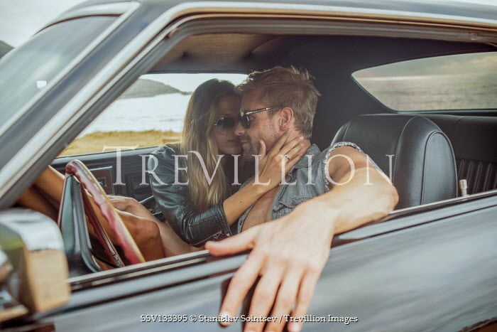 Stanislav Solntsev Intimate couple sitting in car