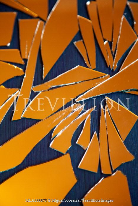 Miguel Sobreira Broken mirror shards on table