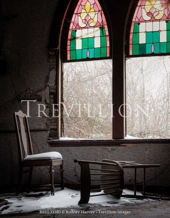 Rodney Harvey Chairs under snow by broken church windows