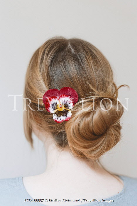 Shelley Richmond Young woman with hair bun and red flower
