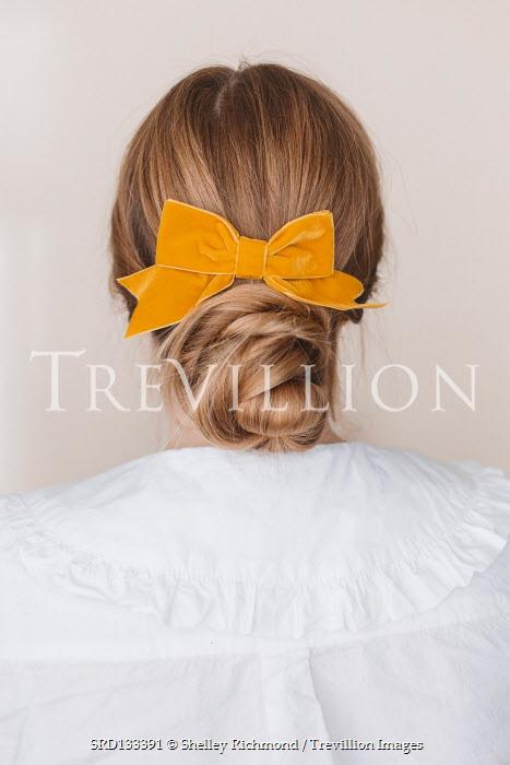 Shelley Richmond Young woman with hair bun in ribbon