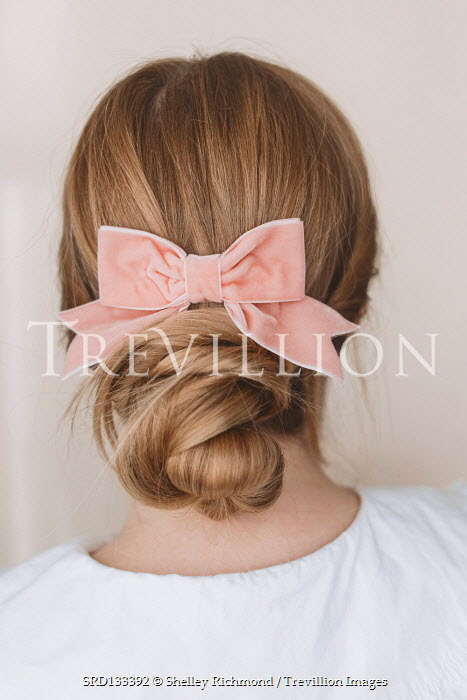 Shelley Richmond Young woman with hair bun in ribbon