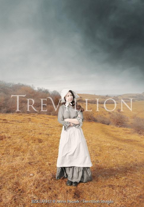 Anna Buczek Victorian maid in uniform standing on hill