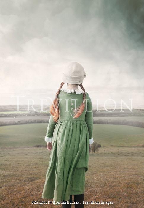 Anna Buczek Victorian girl in green dress standing in field