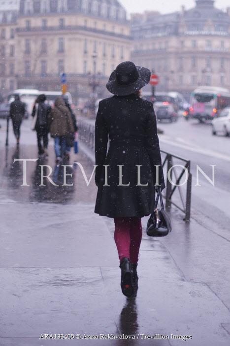 Anna Rakhvalova WOMAN IN HAT WALKING IN WINTRY CITY Women