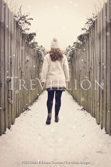 Emma Goulder BLONDE WOMAN WALKING IN SNOWY ALLEYWAY Women