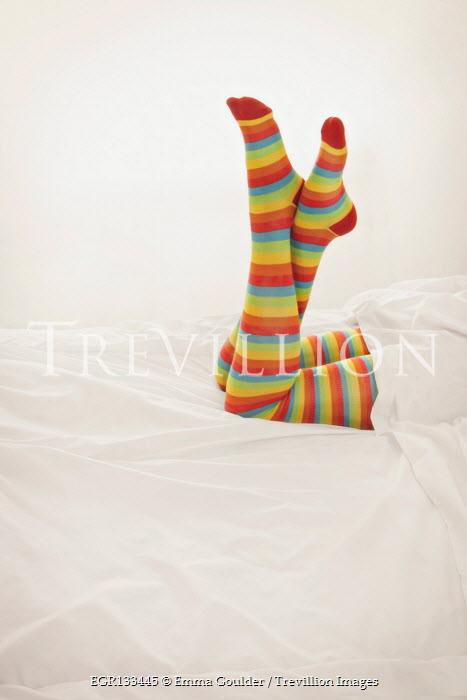 Emma Goulder FEMALE LEGS IN STRIPY TIGHTS LYING ON BED Women