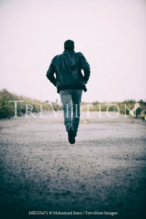 Mohamad Itani MAN IN LEATHER JACKET RUNNING ON ROAD Men