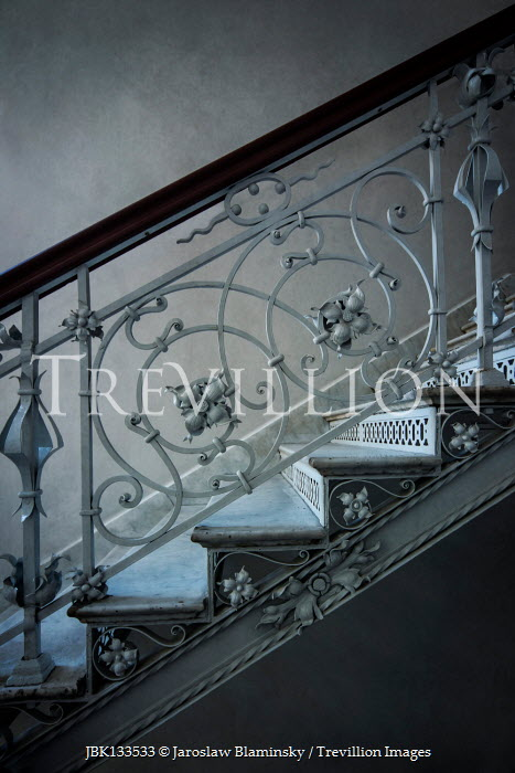 Jaroslaw Blaminsky WHITE STAIRCASE WITH ORNATE WROUGHT IRON Stairs/Steps