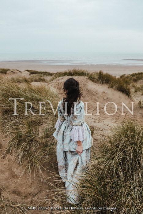 Matilda Delves HISTORICAL WOMAN STANDING IN SAND DUNES Women