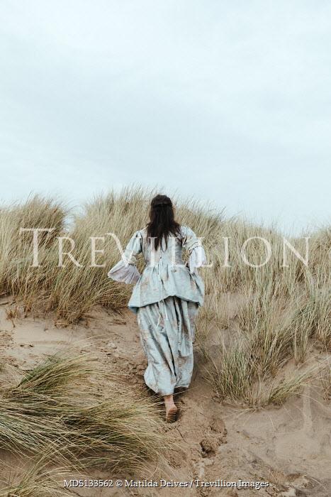 Matilda Delves HISTORICAL BRUNETTE WOMAN WALKING IN SAND DUNES Women
