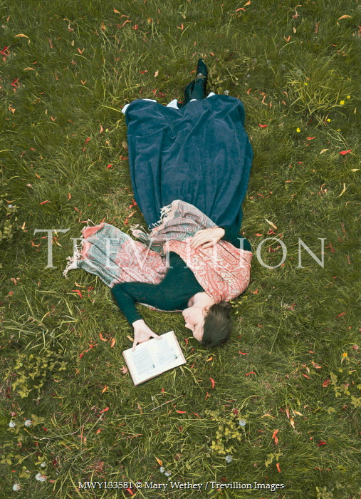 Mary Wethey HISTORICAL WOMAN WITH BOOK LYING ON GRASS Women