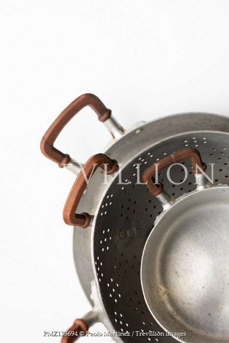 Paolo Martinez STACK OF IRON SAUCEPANS AND COLANDER