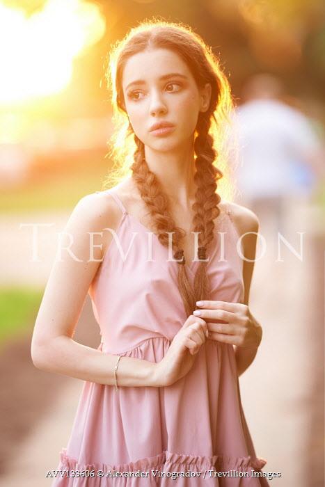 Alexander Vinogradov GIRL WITH PLAITS STANDING OUTDOORS IN SUNLIGHT Women