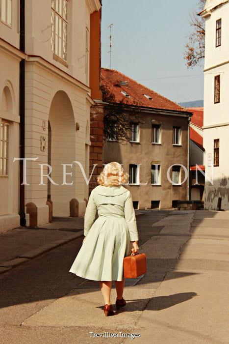 Jasenka Arbanas BLONDE RETRO WOMAN CARRYING SUITCASE IN TOWN