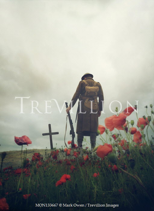 Mark Owen WW1 SOLDIER RIFLE BY GRAVE WITH POPPIES