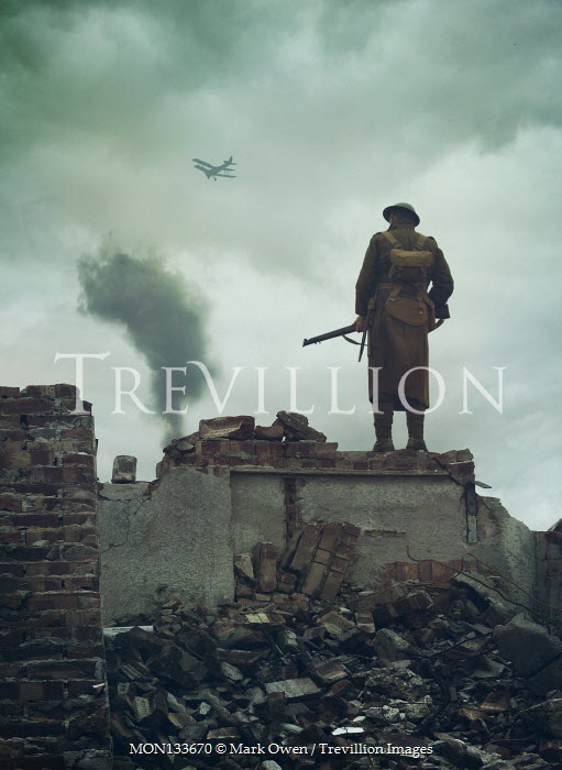 Mark Owen WW1 SOLDIER ON BOMBED BUILDING WITH AEROPLANE