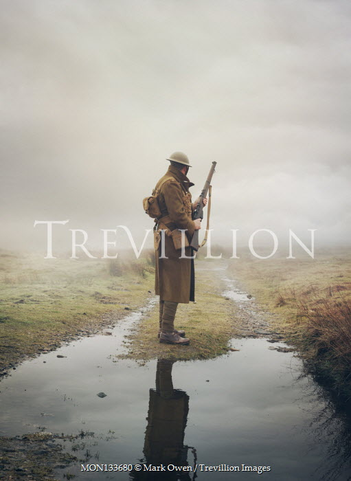 Mark Owen WW1 SOLDIER STANDING IN FIELD WITH PUDDLES