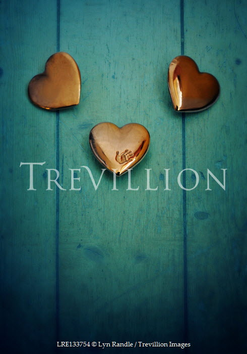 Lyn Randle THREE GOLD HEARTS ON TURQUOISE WOOD