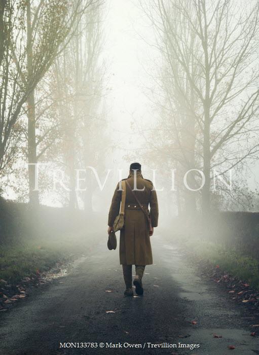 Mark Owen SOLDIER WALKING IN FOGGY COUNTRY ROAD