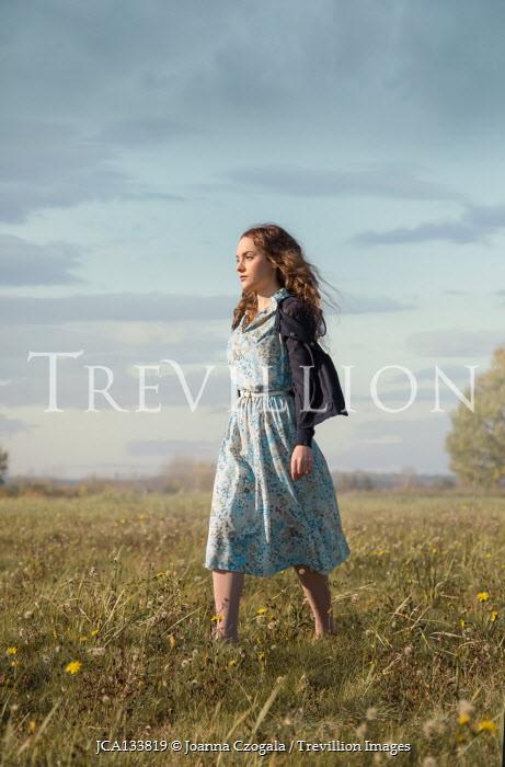 Joanna Czogala GIRL IN FLORAL DRESS WALKING IN COUNTRYSIDE