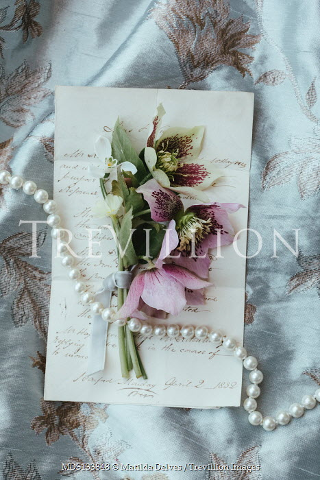 Matilda Delves FLOWERS AND PEARLS LYING ON LETTER AND FABRIC
