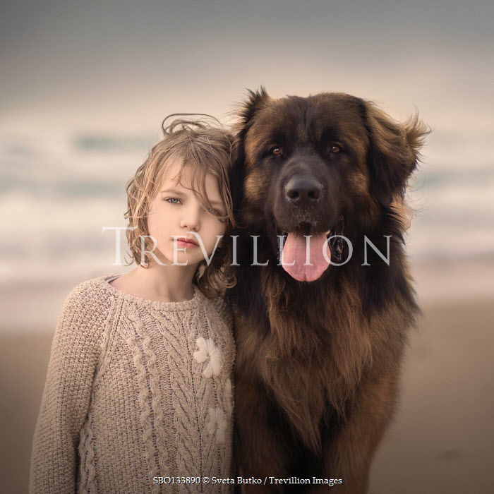 Sveta Butko LITTLE GIRL WITH LARGE DOG ON BEACH