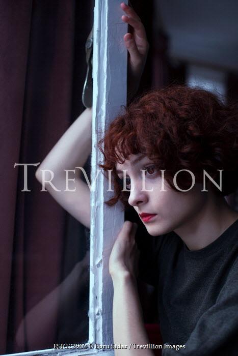 Ebru Sidar WOMAN WITH RED HAIR DAYDREAMING BY WINDOW