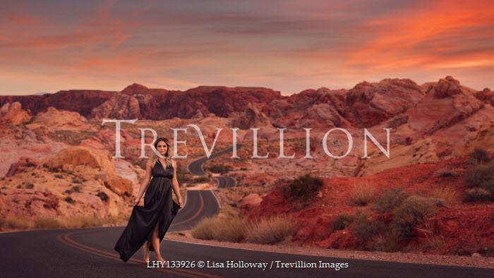 Lisa Holloway WOMAN IN GOWN WALKING IN DESERT ROAD