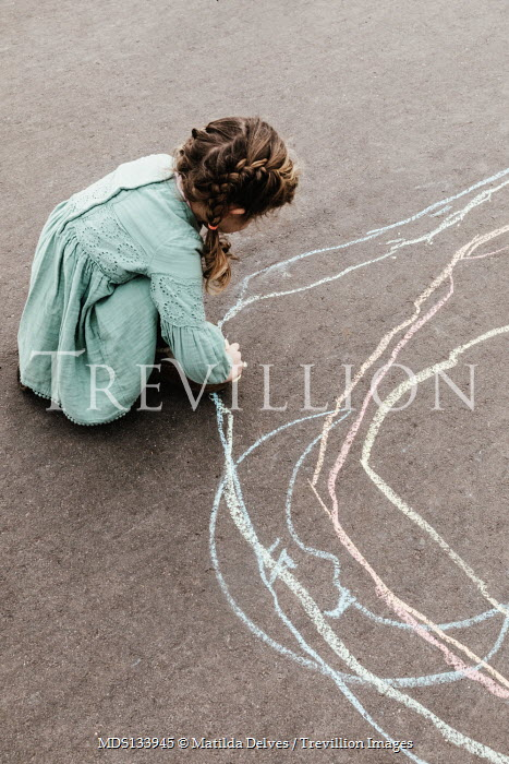 Matilda Delves LITTLE GIRL DRAWING WITH CHALK ON GROUND