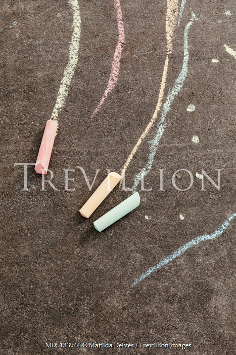 Matilda Delves COLOURED CHALK LYING ON GROUND OUTDOORS