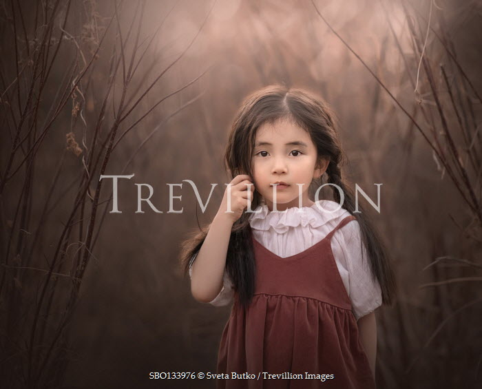 Sveta Butko SERIOUS LITTLE ASIAN GIRL STANDING IN COUNTRYSIDE