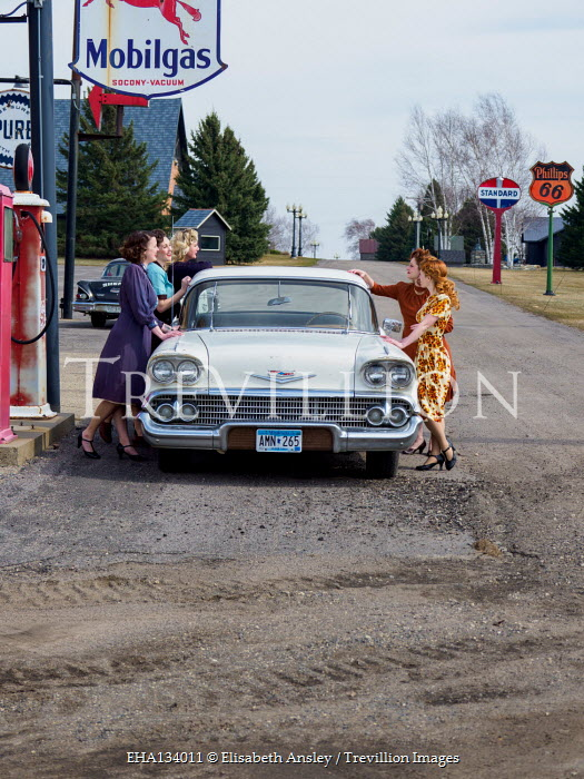 Elisabeth Ansley RETRO WOMEN WITH CAR AT GAS STATION