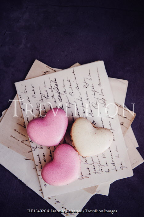 Isabelle Lafrance MACAROON HEARTS LYING ON LETTERS