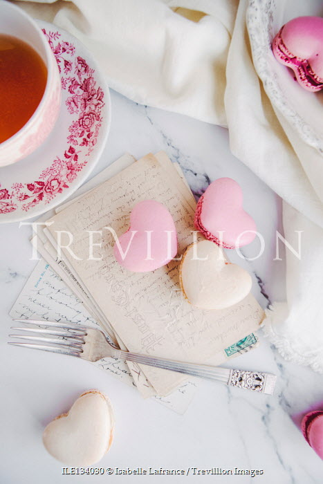 Isabelle Lafrance MACAROONS ON TABLE WITH POSTCARDS AND TEACUP