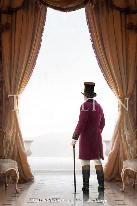 Lee Avison regency gentleman looking out of a floor to ceiling window
