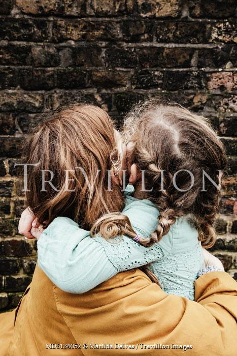 Matilda Delves WOMAN HUGGING LITTLE GIRL OUTDOORS