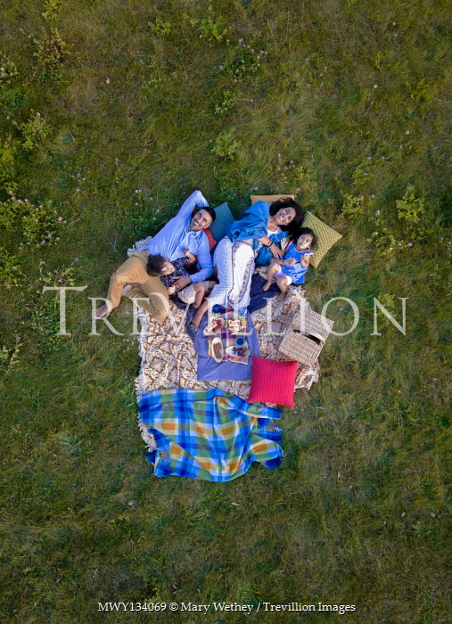 Mary Wethey HAPPY FAMILY WITH PICNIC ON RUGS IN FIELD