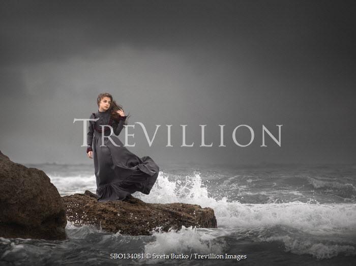 Sveta Butko HISTORICAL WOMAN ON ROCK BY STORMY SEA