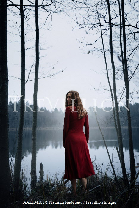 Natasza Fiedotjew woman in red dress at lake in woods