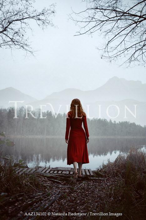 Natasza Fiedotjew woman in red dress at mountain lake